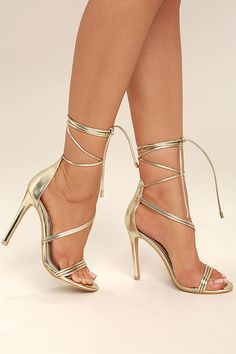 Be the princess you were born to be in the Ameerah Gold Lace-Up Heels! From a peep-toe upper, vegan leather straps create a sexy, asymmetrical upper with long tying laces (and gold aglets).