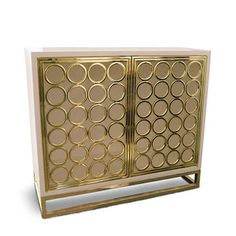 This Golden Circles credenza by Davinci is stunning and so old hollywood glam.