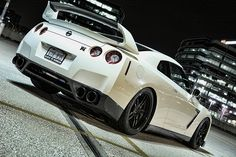 Nissan GT-R, I don't know why but cars shot in a city backdrop are so so beautiful.