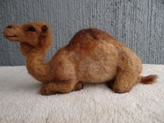 This needle felted wool Dromedary Camel will be created just for you! He will be firmly felted over a wire skeleton for strength and gentle posing. He will feature glass eyes, and will measure about 8 tall and 8 long. He will be felted using the finest wool! It will take me 2-4 weeks to create them just for you. Since this is a custom created sculpture, there will slight be variations from the photos as each critter is unique. I can create you a Bactrian Camel if you prefer! Just let men…