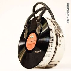 Retro Record Bags - Check out these latest retro music inspired handbags, from Living Dead Souls' shoulder guitar bags, to Momaboma's vinyl record-shape ha. Vinyl Record Crafts, Vinyl Records, Unique Purses, Unique Bags, Purses And Handbags, Leather Handbags, Sacs Design, Guitar Bag, Cassette