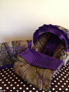 3 Piece Set purple and REALTREE CAMO fabric infant Car Seat Cover and Canopy Cover and Diaper Bag  & Huggy Blanket with Free Monogram. $105.00, via Etsy.