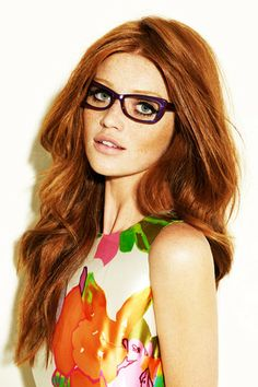 Cintia Dicker. Glasses? yes please! Bright granny dress with fruit on it? A must!