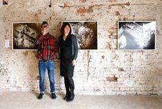 "Filmmaker Matt Hulse and Julia Zinnbauer in front of his photo series named ""Sniper"" at the Düsseldorf Photo Weekend, WP5 / Worringer Platz (Photo: Jürgen Grölle) #MattHulse #JuliaZinnbauer #Düsseldorf #photography #art #SPACEFALL #WorringerPlatz #telescopicboy #Korea #telescopelense"