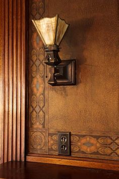 Restoring an Eclectic Mansion - The bronze lighting fixtures and leatherette wallcovering are original.