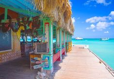 Sunny skies, blue Caribbean waters and classic cocktails, it's instant paradise at these top beach bars in Aruba! Caribbean Vacations, Beach Resorts, Best Resorts In Aruba, Vacation Resorts, Aruba Restaurants, Places To Travel, Places To Visit, Travel Destinations, Travel Pics