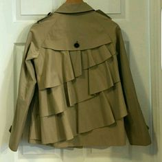 Ruffle Trench Raincoat Excellent condition - only worn twice. Beautiful asymmetrical ruffles down the back. Would fit a medium as well. Moda International Jackets & Coats Trench Coats