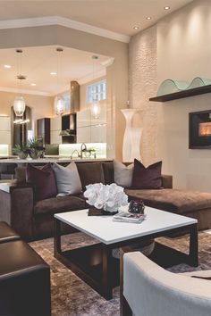 A gallery wall, plush brown sectional, and mix of patterns keep ...