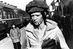 David Bowie traveling by Trans-Siberian Express from Japan to Moscow through Russia with his band members in 1973. His looks cause quite a stir in the soviet world.