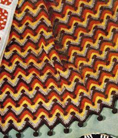 Step into a time machine with this crochet blanket pattern! That 70s Afghan is both groovy and comfortable. The chevron ripple crochet pattern that adorns this blanket makes it easy to crochet and infuses it with a mellow vibe.