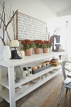 I love this looooong buffet table! I could prob. Make it & love the fall decor tablescape it's topped with as well!