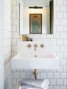 Brass fixtures.  Photo Gallery: Mandy Milks Bathroom Makeover | House & Home