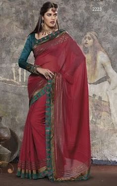 Dark pink color jute material saree with a contrasting blue silk and shimmer rust band running across the length of the saree.  Look pretty in pink with this saree that would be a good choice for an event or a party.