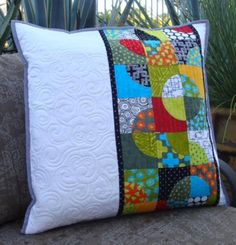 """Here's a fun idea! Make pillows for patio benches or chairs using @AccuQuilt dies. This pillow was made using the GO! Drunkard's Path 4"""" finished die. Why not create a table runner to match?"""