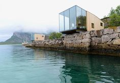 Cottages by architect Snorre Stine's on an island in a Norwegian fjord.
