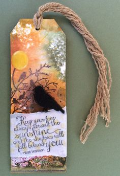 Tim Holtz style tag with Stampin' Up stamps!  Used Ray of Sunshine, Kinda Eclectic, Choose Happiness and Serene Silhouettes stamp sets.  Tag by Beverly Stewart.