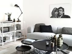 Shades of gray in the living room, but I'd love for us to have multiple modern frames clustered-gallery style on the wall that were black frames, grey matte, and color photograph. It would be a cute feature of the room.
