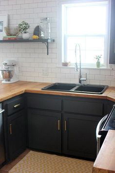 Dark grey cabinets and wooden countertops | Sophie Leger's recent home renovation