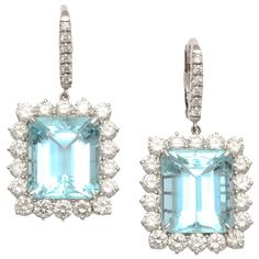 Diamond and Aquamarine Platinum Earrings | From a unique collection of vintage lever-back earrings at http://www.1stdibs.com/jewelry/earrings/lever-back-earrings/