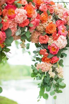 Coral and Green Spring Wedding Color Ideas: White bridal gown, Coral bridesmaid dresses, Coral and green wedding arch and Spring Green lawn, neutral table linens with coral napkins and gold or silver tableware. Orange And Pink Wedding, Coral Wedding Flowers, Spring Wedding Colors, Lavender Flowers, Green Wedding, Floral Wedding, Wedding Bouquets, Coral Orange, Trendy Wedding