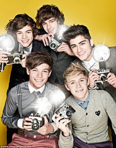 One Direction's Harry Styles, Niall Horan, Zayn Malik, Liam Payne and Louis Tomlinson holding retro style cameras with giant flashbulbs in a cute photo shoot. via dailymail.co.uk