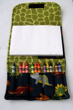 Crayon wallet. I like this one. If kiddo is working on a small work-space the part that is holding the crayons won't be dumped out on accident.