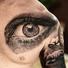 Black and grey photo-realistic eye tattoo by @zakitattoo. #underratedink…