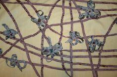 I made this fabric, 1/7 of it is in Australia. Seam binding, cream velvet and beads