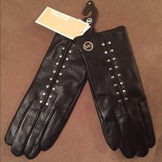 Michael Kors Leather Gloves Brand new! Black leather Michael Kors gloves with tech finger. Has silver studs with MK on one glove. Size medium but fits like a small. Meant for long fingers! Hence why they don't fit my baby hands! Michael Kors Accessories Gloves & Mittens