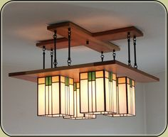 Prairie Chandelier with 8 rods Handmade in the  U.S.A. by Mission Studio. Customize your light fixture by selecting from a variety of wood, glass colors and hanging  heights.