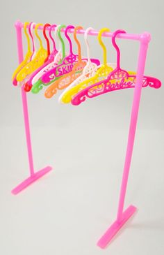 "These hangers are genuine Barbie vintage!! All are in great shape in a variety of gorgeous colors and say ""BARBIE"" within the filigree design. There are even a few ""FRANCIE"" and ""SKIPPER"" signature ha"
