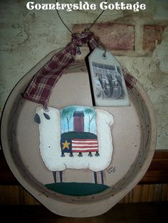 Hey, I found this really awesome Etsy listing at https://www.etsy.com/listing/78888603/handpainted-primitive-sheep-pie-pan hanger