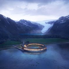 Snøhetta has revealed plans for a sustainable ring-shaped hotel nestled at the base of northern Norway's Almlifjellet mountain, within the Artic Circle.