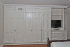 Built In Closet Design - Great idea for guest bedroom. Great spot to put a tv and extra drawers.