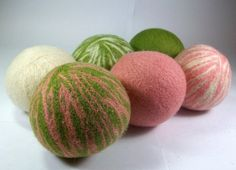 Love these!!!  Wool Dryer Balls instead of dryer sheets... great for the environment and dries your clothes faster! woot!