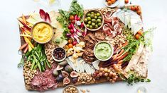 How to put together a deliciously summery fruit and nut platter for easy entertaining, plus how to take the platter into fall.