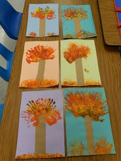 handprint trees...we did a little one day project talking about warm colors.  We discussed  the difference between evergreen trees and deciduous trees.  And,  we also talked about the reasons these trees lose their leaves, which is to conserve water and better survive the winter months.  Sort of a tree hibernation period.  The kids loved getting messy and doing the layers of paint.