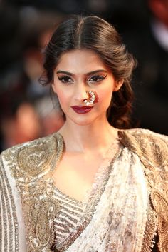 Sonam looked striking at the Cannes Film Festival in 2013. She wore multiple bold (and stunning!) beauty styles simultaneously, including a large nose piercing and dramatic cat eye.