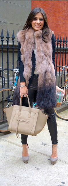 Celine handbag, leather pants, pumps and hopefully the vest is faux fur. Love it.