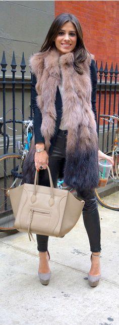 Celine handbag, leather pants, pumps and hopefully the vest is faux fur. Love it.