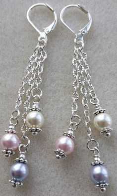 Pink, platinum and cream Swarovski pearls make a beautiful compliment to any outfit. Priced at $20