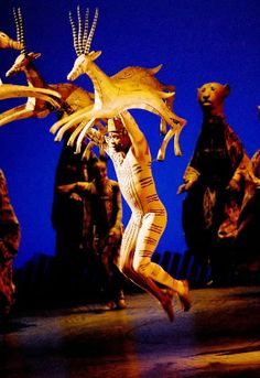 Julie Taymor's 'Lion King' Running African Gazelles! Awesome Awesome Awesome! I love the stripes painted on the man's side mimicking the gazelle's horns.