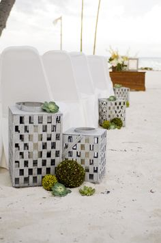 modern beach decor for this ceremony in the sand