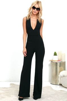 Your admirers will have a lot to say about their love for you in the Thinking Out Loud Black Backless Jumpsuit! Medium-weight knit is formed to a sleeveless bodice, with V-neck, darting, and wide straps that cross over the open back. Bit of elastic at the waist tops the wide-leg pants. Hidden back zipper. As Seen On Lindsay of Lindsay Marcella blog!