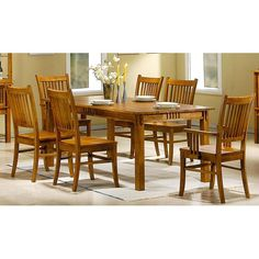 This Angelica Mission country style dining set has a smooth surface, table with sleek shaker sturdy legs with decorative corbels. This dining set also features matching four side chairs and two arm chairs with slated design backrest.