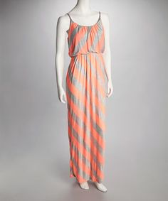 With its breezy elegance and easy-chic silhouette, this marvelous maxi makes an effortless go-to for sensational style. Vibrantly hued multi-directional stripes dial up the trend factor. Size note: This item runs small. The vendor recommends ordering one size up.