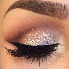 Love the colors eyeshadow with glitter and winged eyeliner.