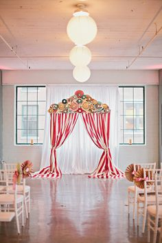 #WhimsicalWeddings - Infuse Fun with your choice of Ceremony #Backdrop! | See More on SMP: http://stylemepretty.com/2013/05/15/st-louis-circus-wedding-from-megan-thiele-studios