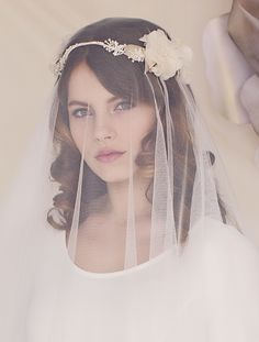 This beautiful bohemian flower crown is a wonderful addition to a romantic wedding. Gorgeous sprays of ivory bugle beads, soft ivory flowers, and shimmering pearlescent faux leathers leaves form this floral creation. Wear with a cascading tulle veil for the ultimate bridal look. Buy online - www.laceandfavour.com