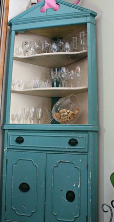 Corks in vintage glass holder ... maybe time to hack off the top of a Mon Ami bottle for this one!  Love the askew cabinet knobs, too...